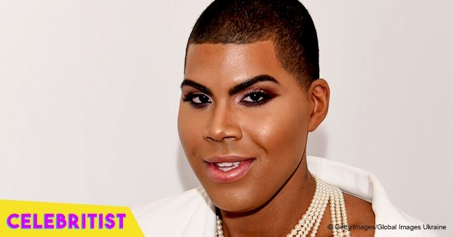 EJ Johnson flaunts his toned legs & bare chest in black sequined mini dress & high-heeled boots