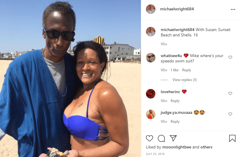 Michael Wright posing side by side with his lover at a beach | Photo: Instagram/michaelwright684