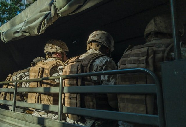 Soldiers in the back of a truck | Source: Unsplash