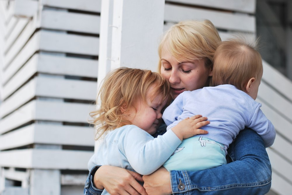 A sad woman with two kids.   Photo: Shutterstock