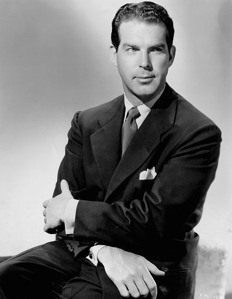 Publicity handout of actor and producer Fred MacMurray (1908-1991). MacMurray sits with his arms crossed over his lap and wears a dark suit and tie | Photo: Getty Images