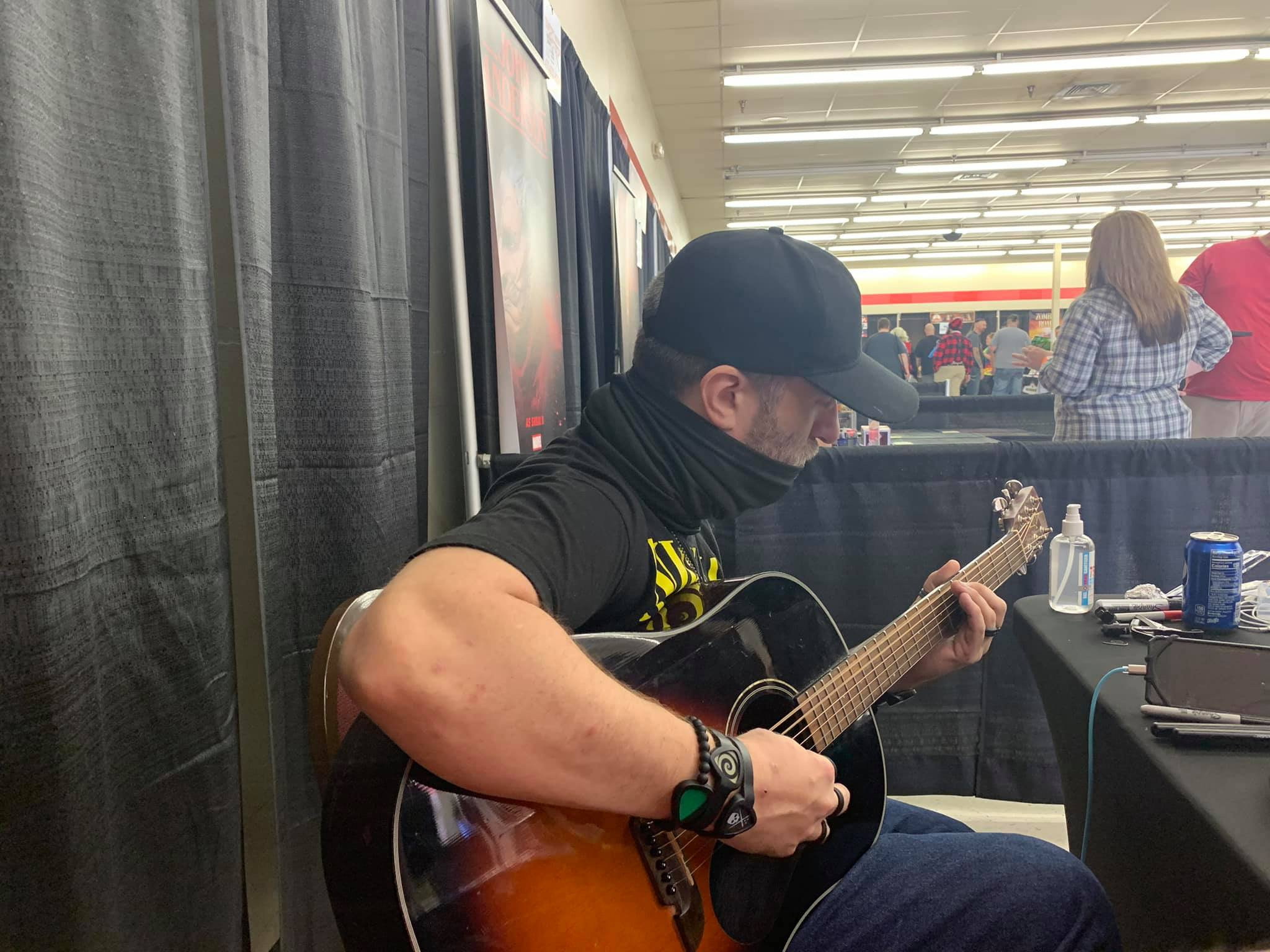 Dustin Diamond having a quiet moment to himself, playing his guitar. October, 2020. | Photo: Facebook/dustindiamond.