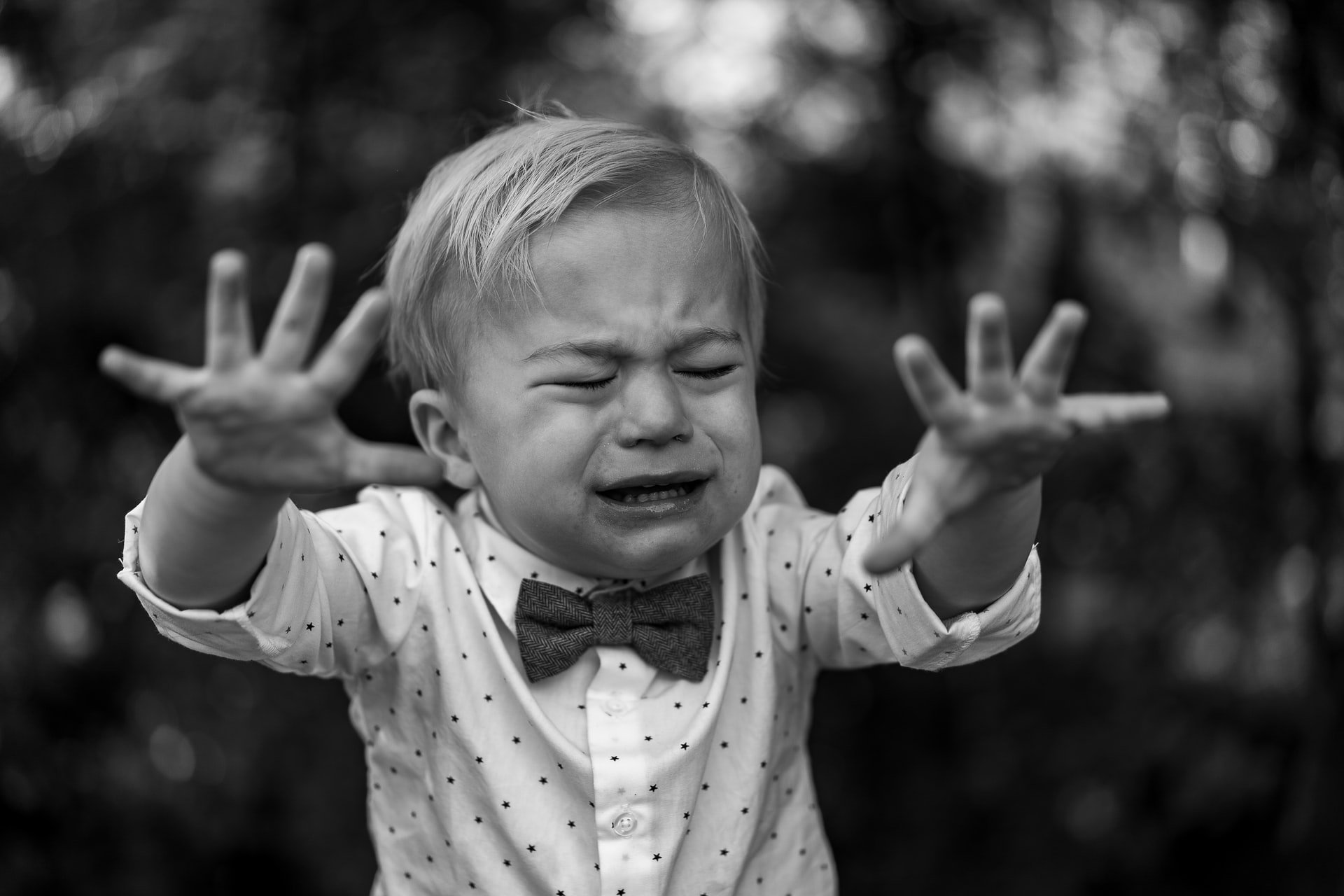Boy crying wearing a bow tie   Source: Unsplash