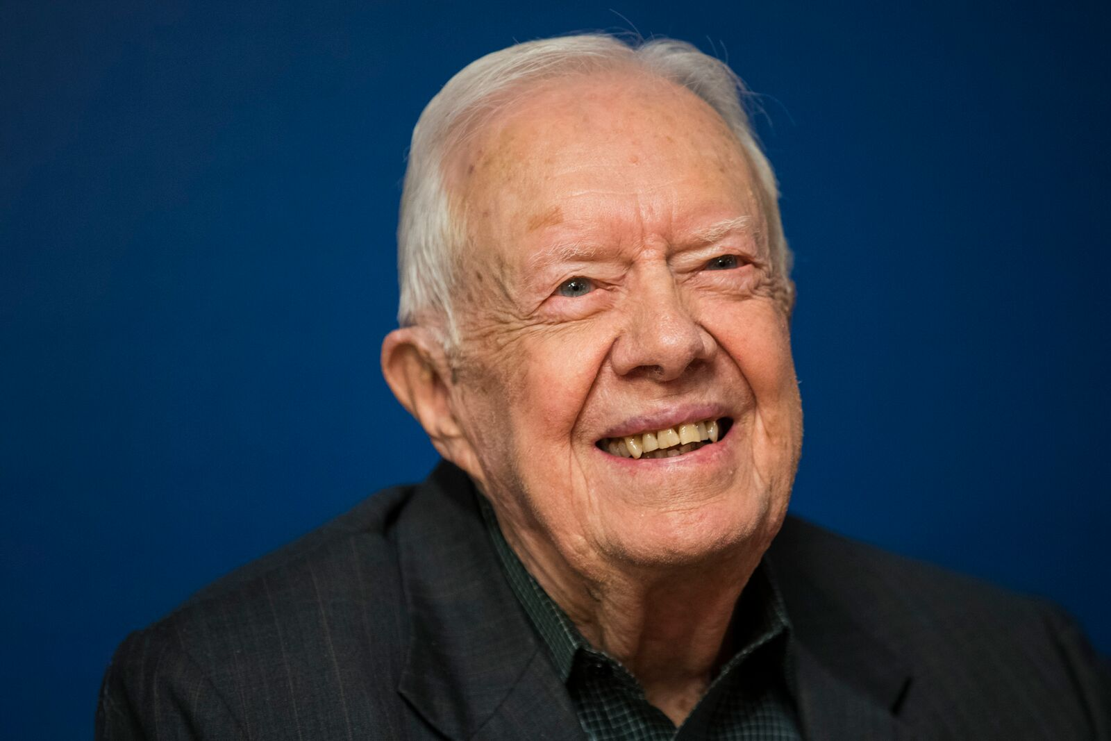 Former U.S. President Jimmy Carter smiles during a book signing event for his new book 'Faith: A Journey For All' at Barnes & Noble bookstore in Midtown Manhattan, March 26, 2018 in New York City | Photo: Getty Images