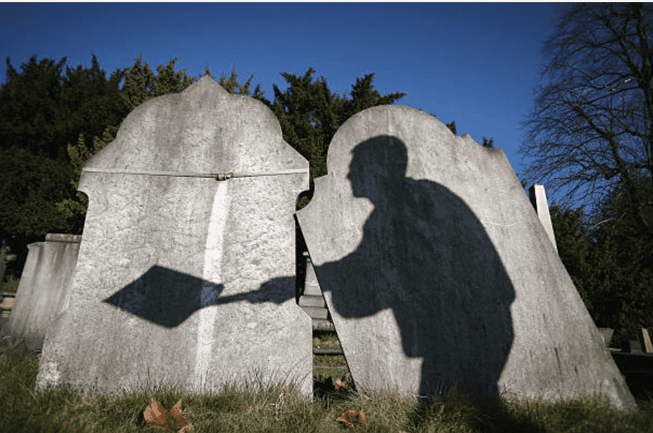 Shadow of tombstone worker reclaiming only graves on March 2, 2009, in London, England | Source: Getty Images