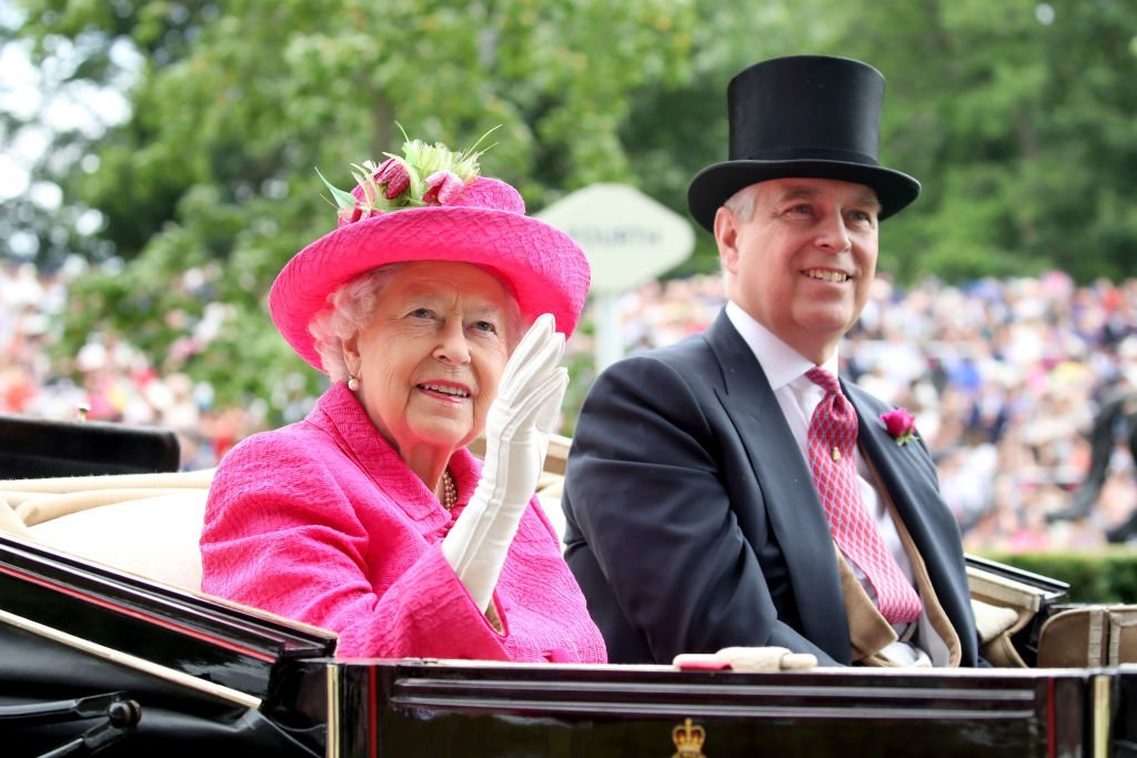 Queen Elizabeth and Prince Andrew wave to crowds from a carriage as they attend the Royal Ascot on June 22, 2017, in Ascot, England | Source: Chris Jackson/Getty Images