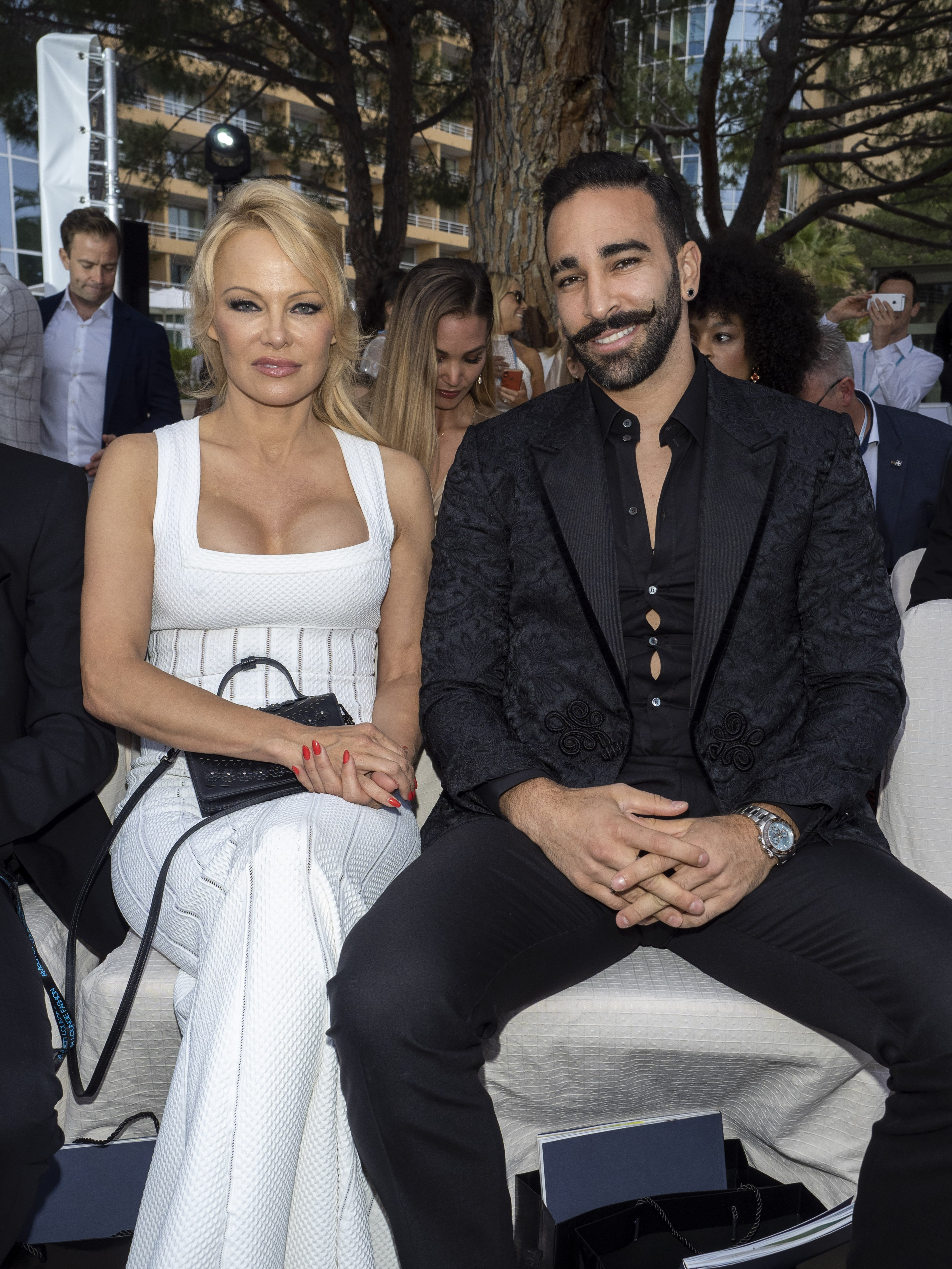Pamela Anderson and Adil Rami attend Amber Lounge 2019 Fashion Show. | Source: Getty Image