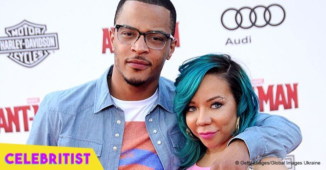T.I. showers Tiny with kisses as they dance at her birthday party in new video
