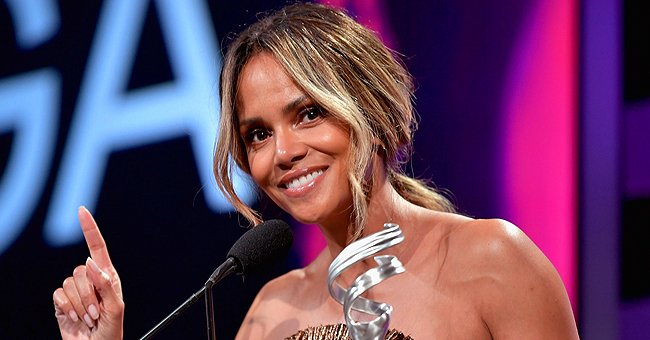 Check Out Halle Berry's Sophisticated Face Mask as She Poses in a Gray Jumpsuit & Hat