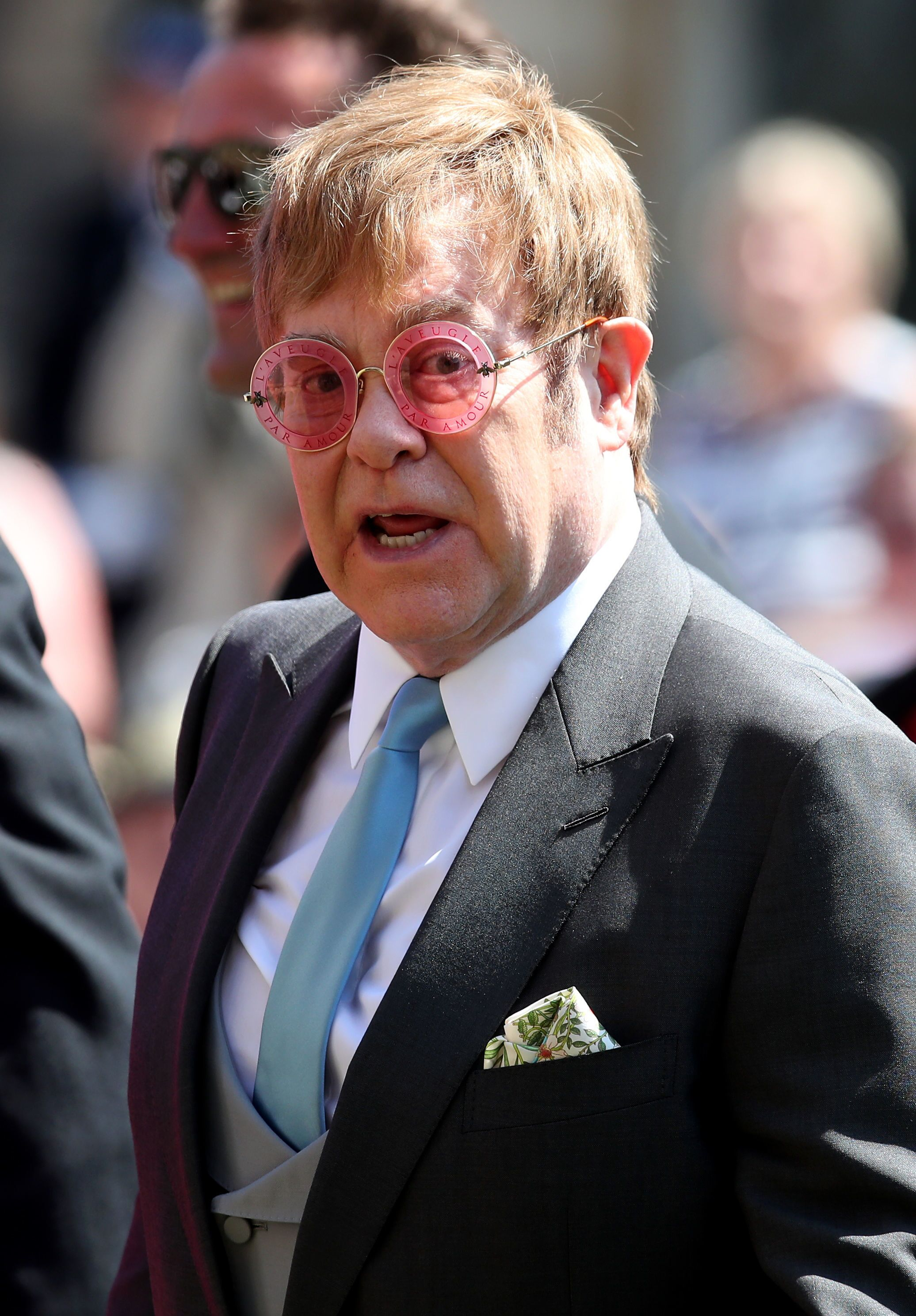 Elton John leaves St George's Chapel at Windsor Castle after the wedding of Prince Harry to Meghan Markle. | Source: Getty Images