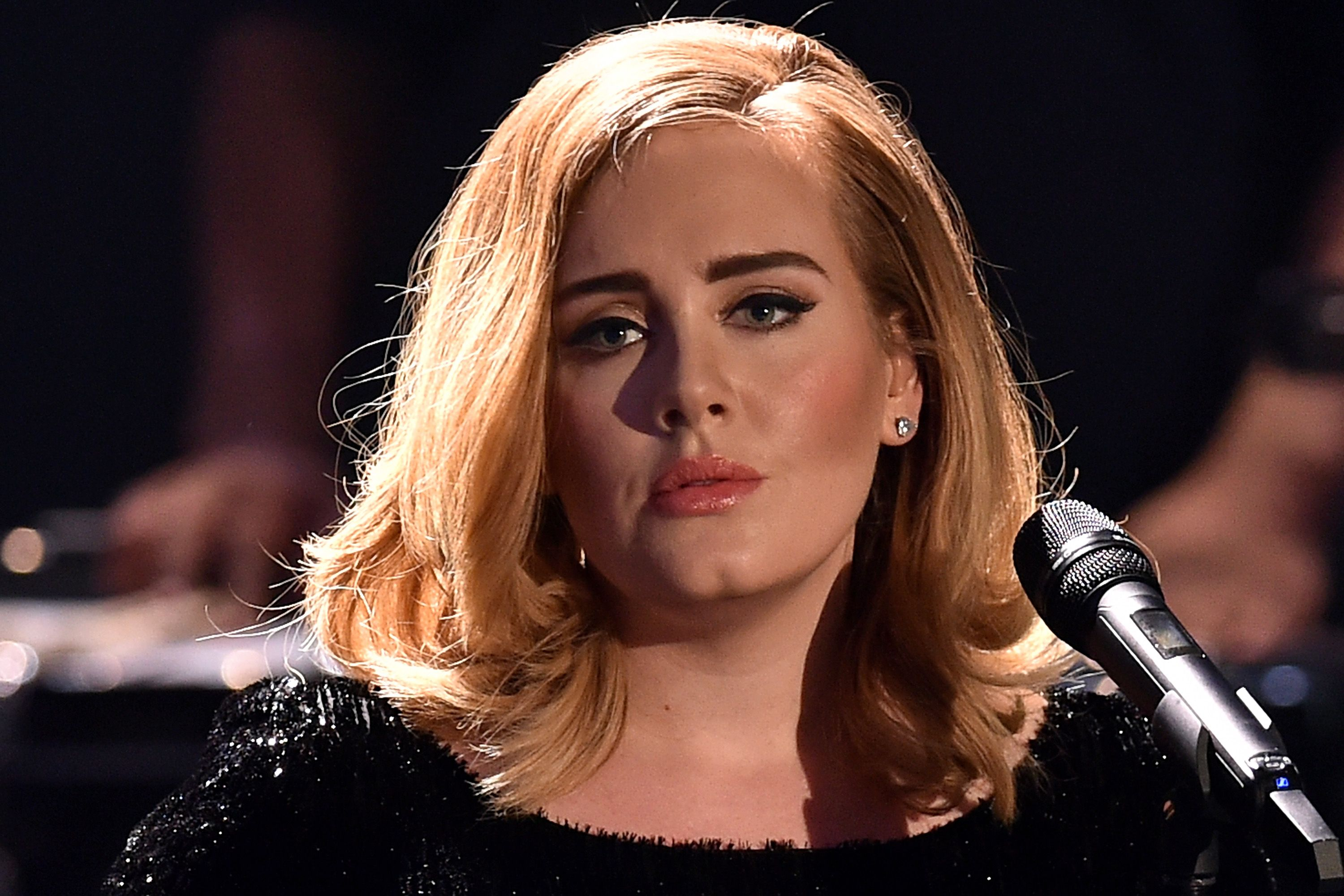 Adele performs live on stage during a television show on December 6, 2015 in Cologne, Germany. | Source: Getty Images