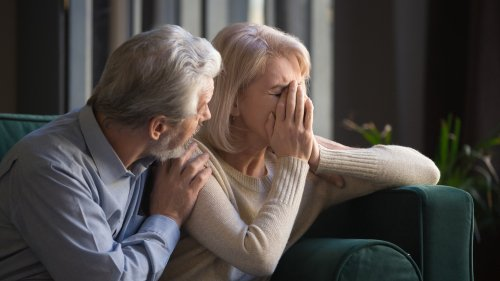 A man sharing bad news with his wife. | Source: Shutterstock.