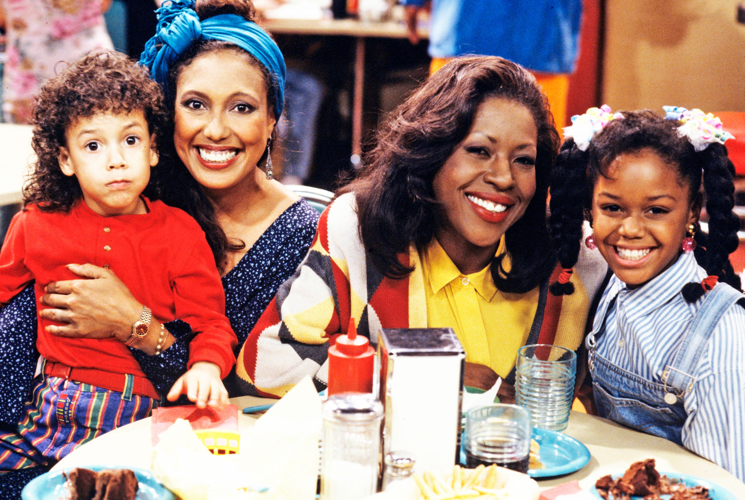 """Bryton James, Telma Hopkins, Jo Marie Payton, and Jaimee Foxworth on the set of """"Family Matters"""" in 1991   Source: Getty Images"""