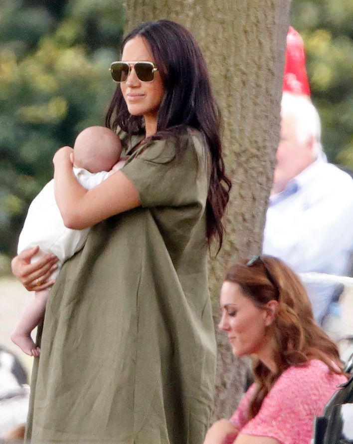 Meghan Markle holding Archie Harrison Mountbatten-Windsor and Catherine Middleton attend the King Power Royal Charity Polo Match, in which Prince William, Duke of Cambridge and Prince Harry, Duke of Sussex were competing for the Khun Vichai Srivaddhanaprabha Memorial Polo Trophy at Billingbear Polo Club on July 10, 2019 in Wokingham, England. | Source: Getty Images