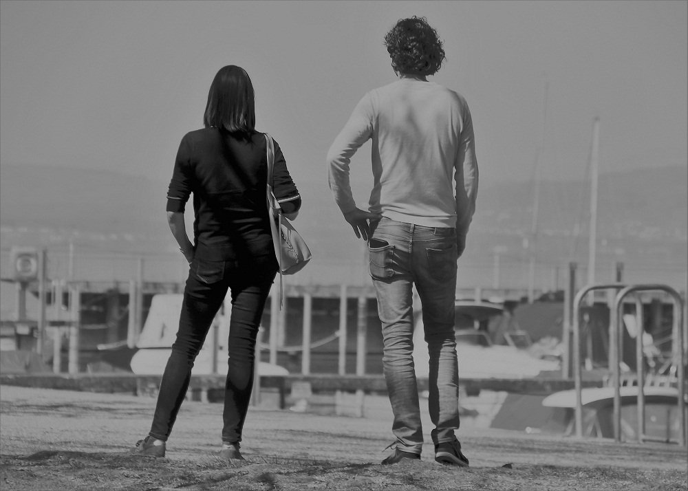 Ex couple keeping distance from each other and looking away on a dock.   Image: Pixabay.