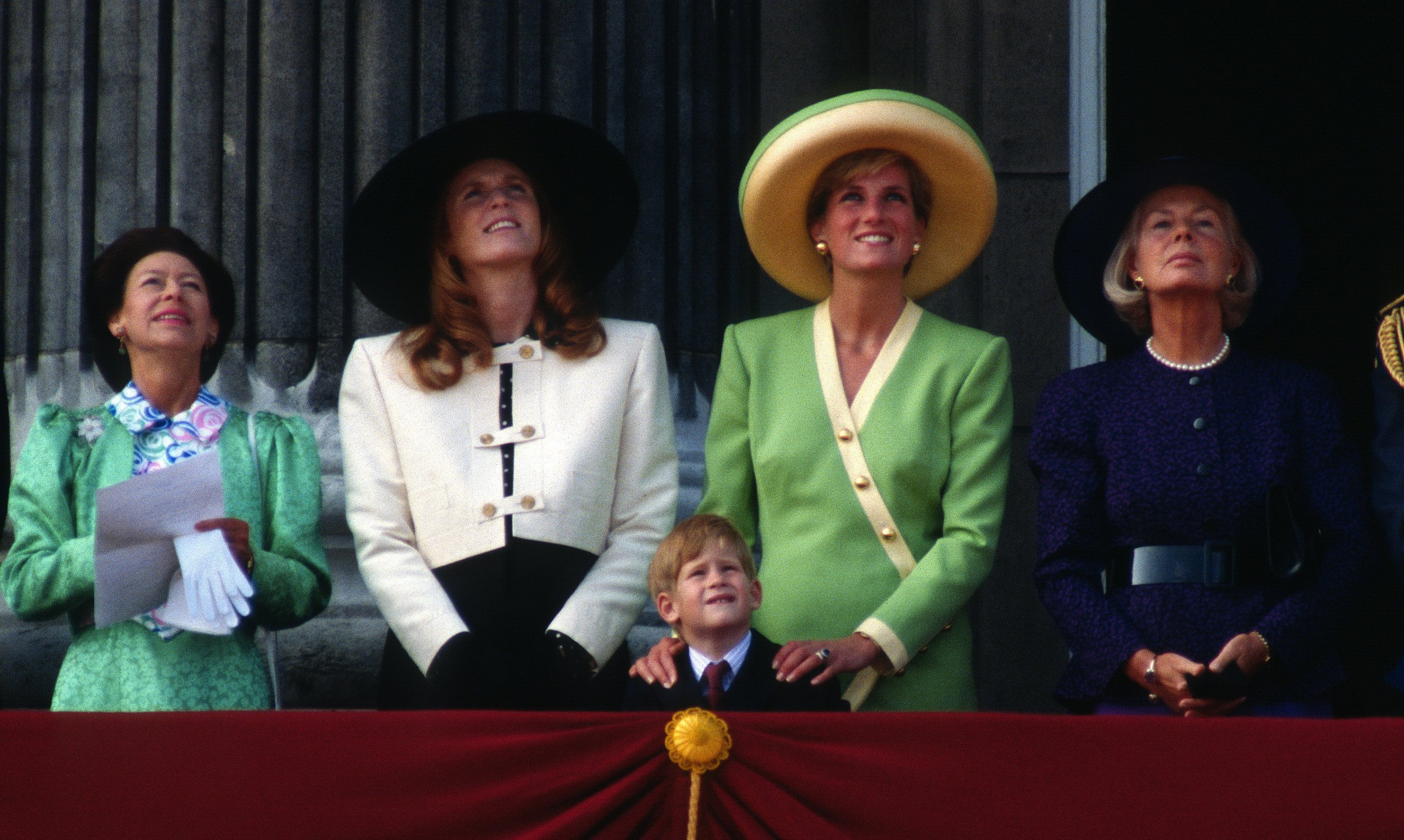 Princess Margaret, Sarah, Duchess of York, Prince Harry, Diana, Princess of Wales and the Duchess of Kent stand on the balcony of Buckingham Palace to watch The Battle of Britain Anniversary Parade on September 15, 1990 | Photo: GettyImages