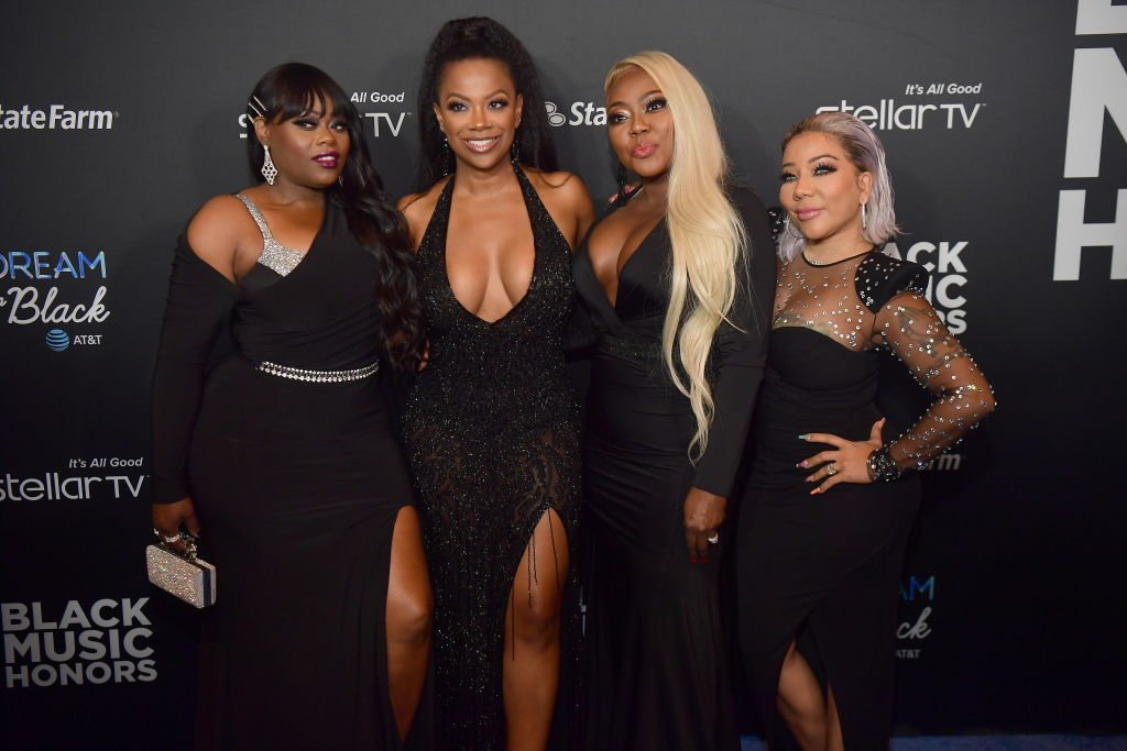 "amika Scott, Kandi Burruss, LaTocha Scott, and Tameka ""Tiny"" Harris of Xscape attend 2019 Black Music Honors