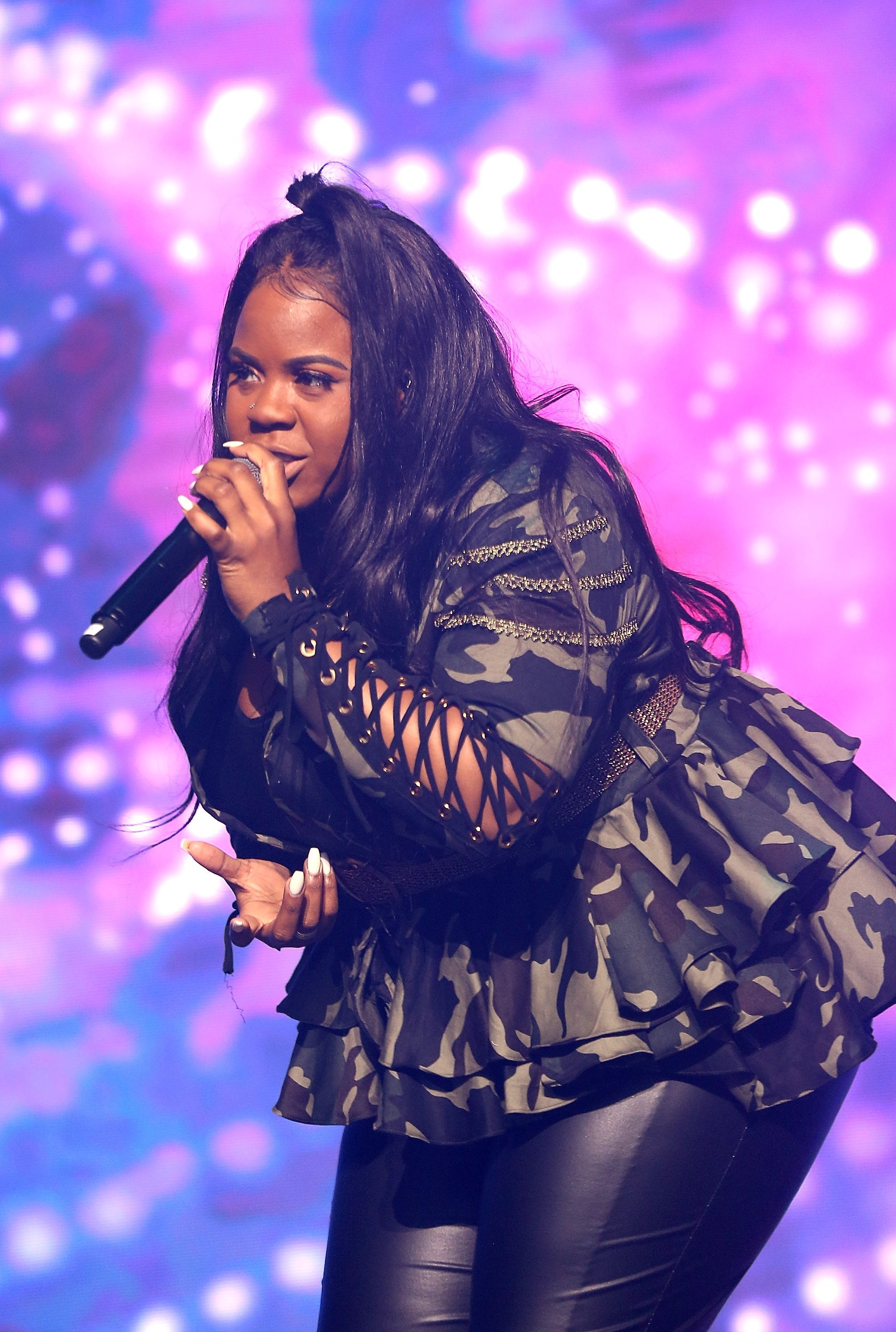 """Tia Mann performs onstage at the David and Tamela """"Against The World"""" Family Tour on October 13, 2018   Photo: GettyImages"""