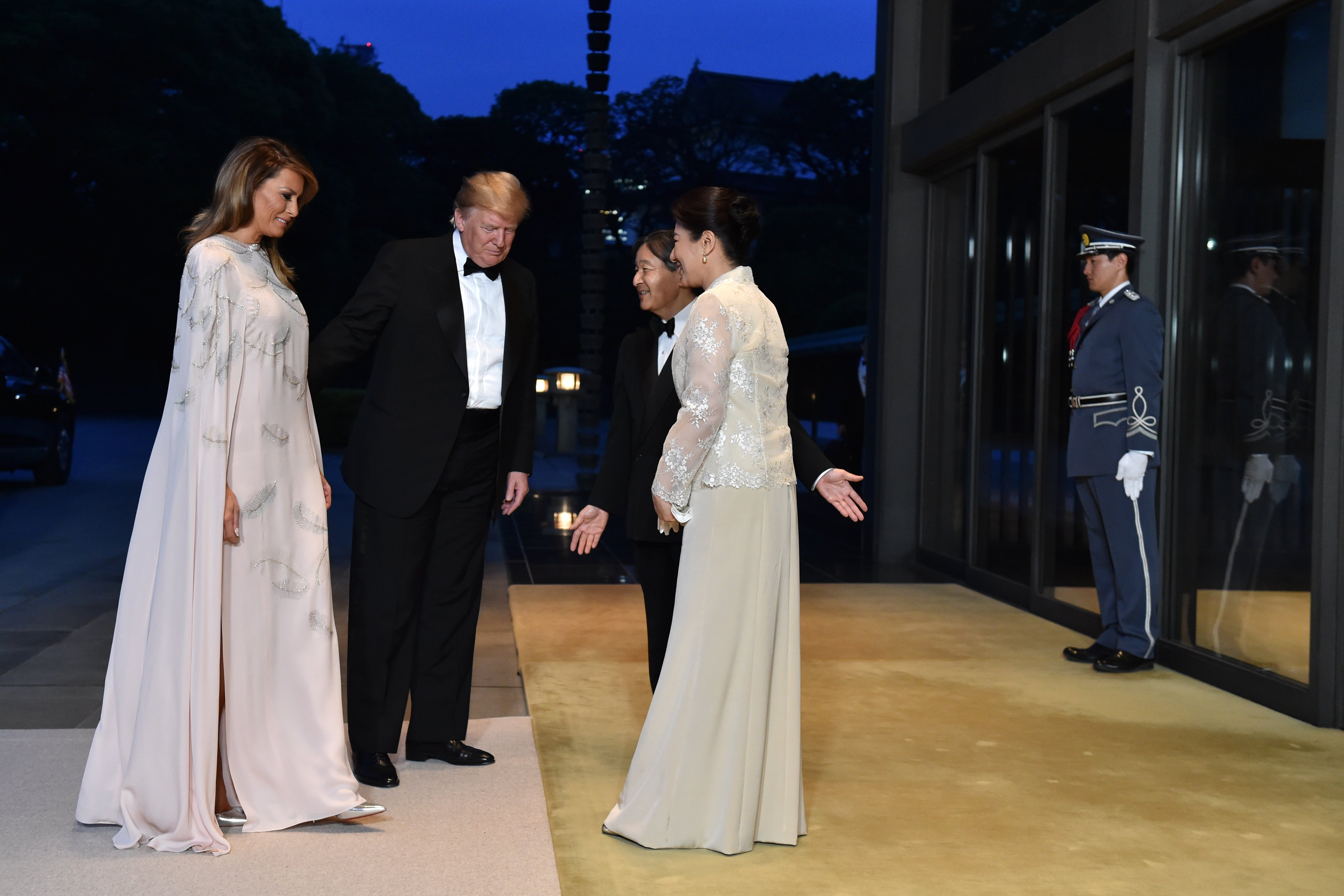 Donald Trump and Melania Trump being greeted by Japan's Emperor Naruhito and Empress Masako at the Imperial Palace in Tokyo, Japan   Photo: Getty Images