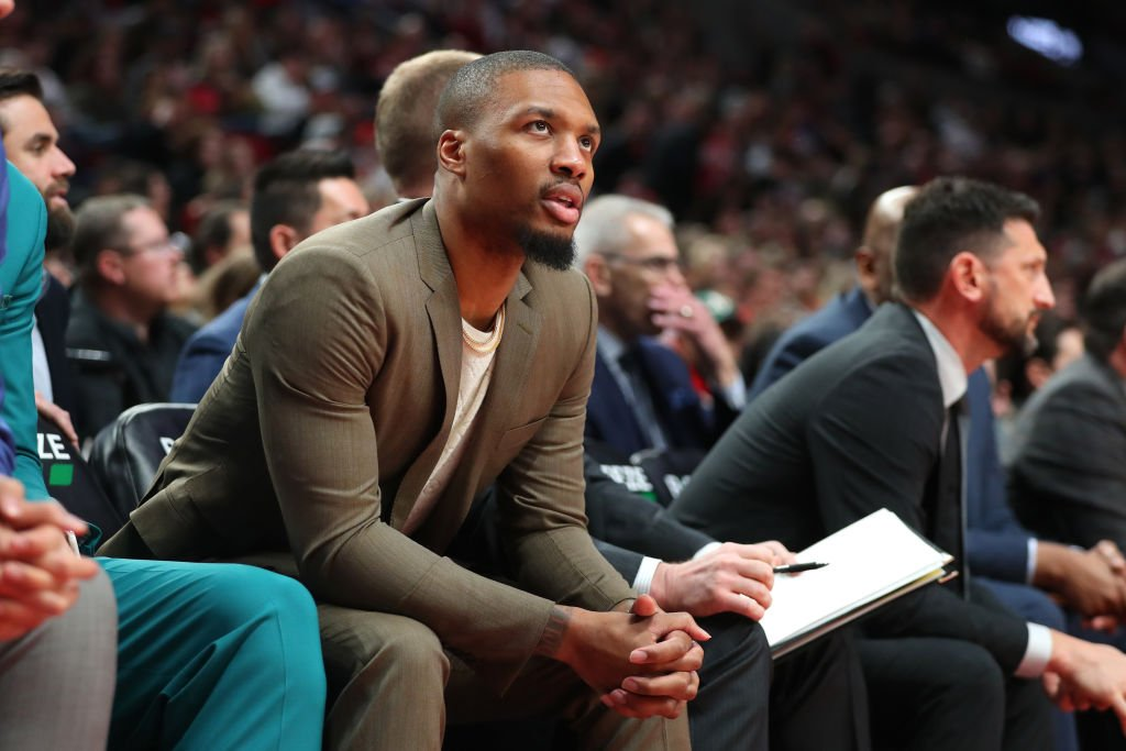 Damian Lillard #0 of the Portland Trail Blazers looks on from the bench in the fourth quarter against the Detroit Pistons during their game at Moda Center on February 23, 2020 in Portland, Oregon | Photo: GettyImages