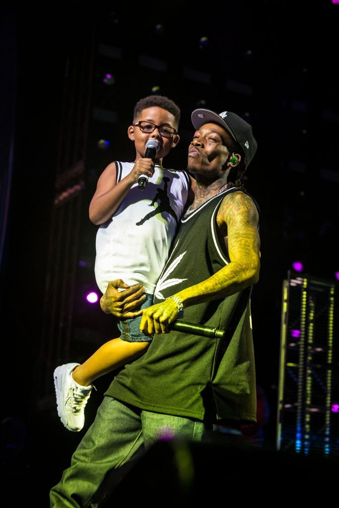 Rapper Wiz Khalifa performing with his son, Sebastian Taylor Thomas in August 2019. | Photo: Getty Images