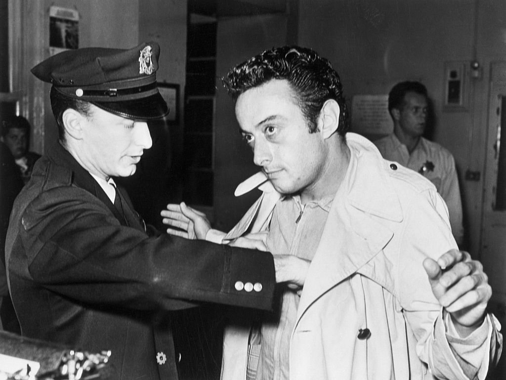 A policeman searches comedian Lenny Bruce after Bruce's arrest for allegedly using obscene language during his act in a North Beach nightclub, the Jazz Workshop circa 1961   Photo: Getty Images