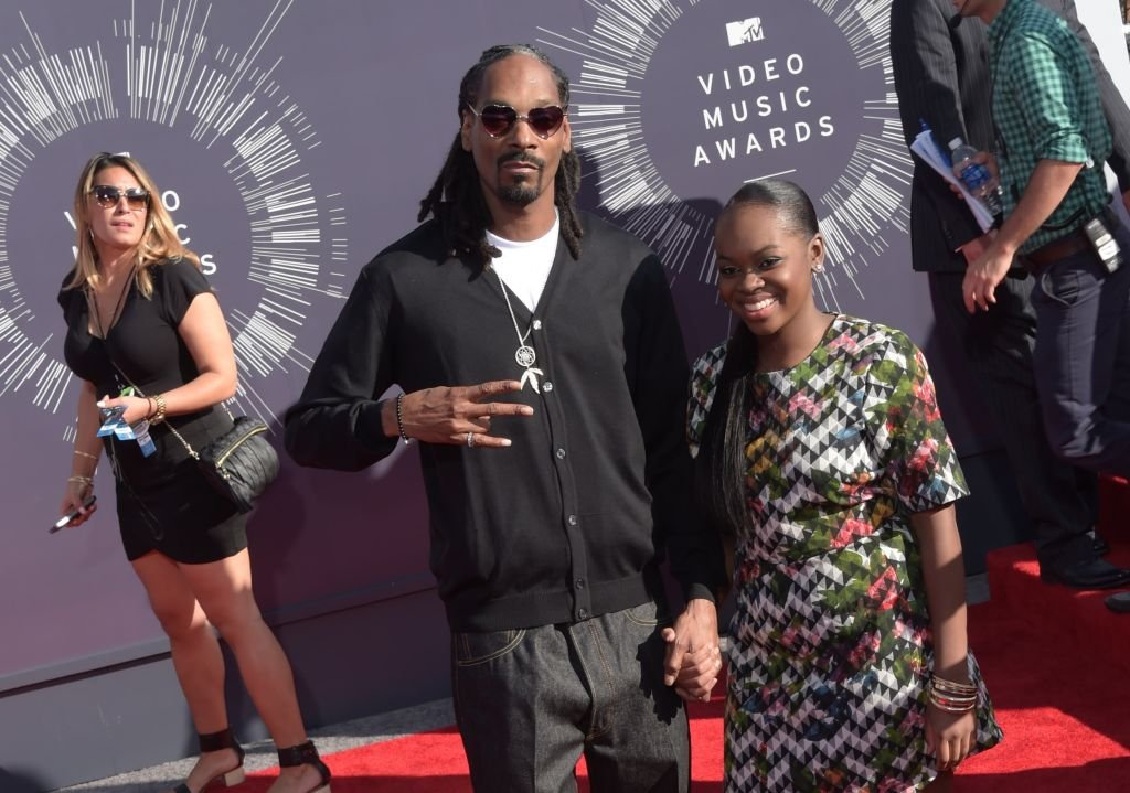 Cori Broadus and Snoop Dogg arrive at the 2014 MTV Video Music Awards at The Forum on August 24, 2014   Photo: Getty Images