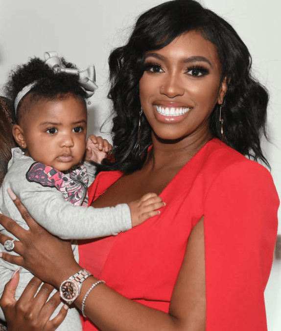 Porsha Williams posed with her daughter Pilar Jhena in her arms at the A3C Festival & Conference on October 10, 2019, in Atlanta, Georgia | Source: Paras Griffin/Getty Images