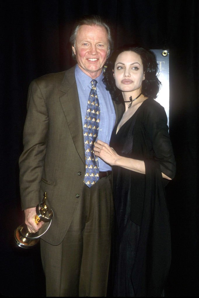 Angelina Jolie with her father Jon Voight at the Vanity Fair Oscar party | Getty Images