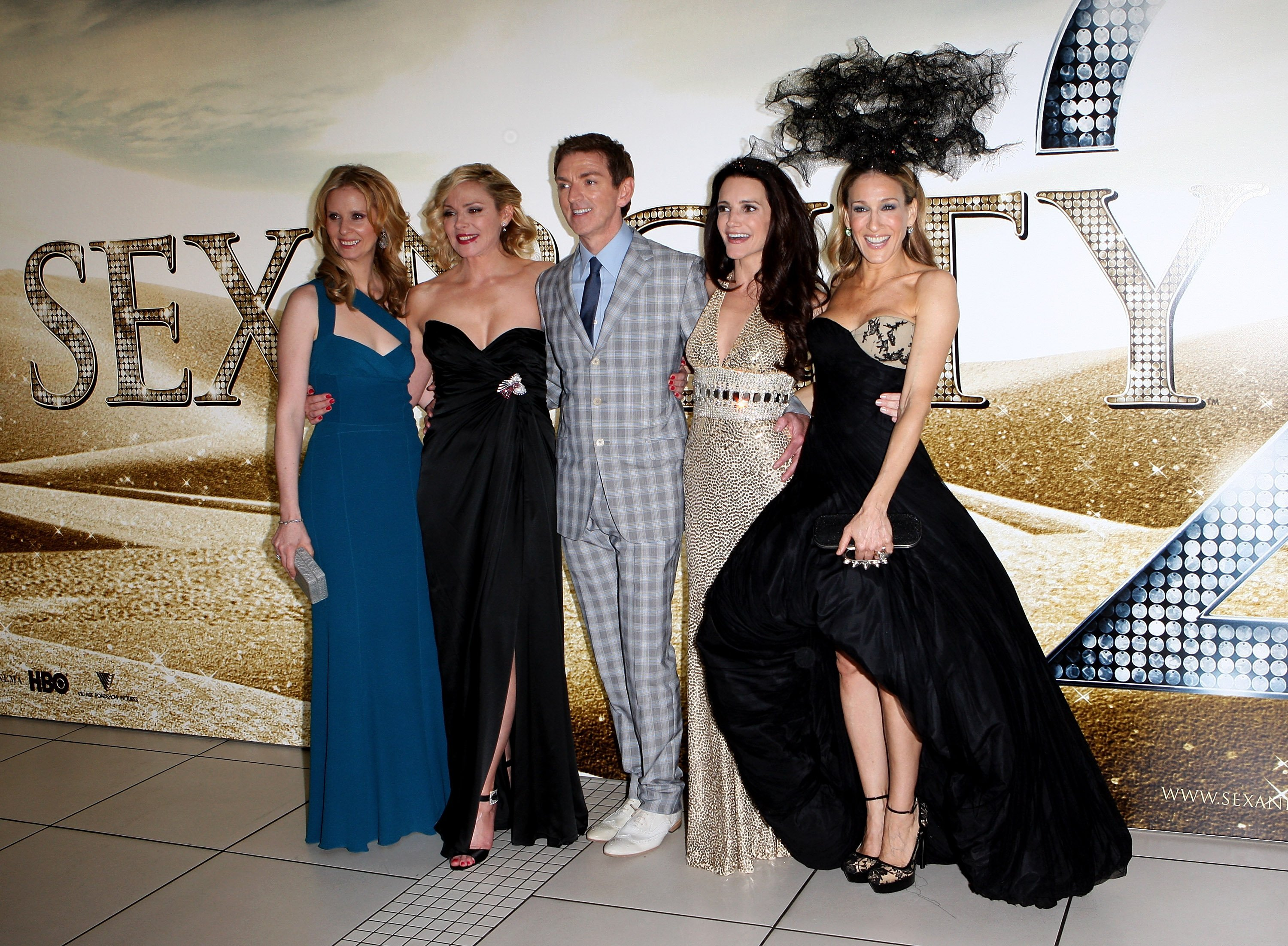 Producer Michael Patrick King (C) and actresses (from L) Cynthia Nixon, Kim Cattrall, Kristin Davis and Sarah Jessica Parker arrive at the UK premiere of 'Sex And The City 2' at Odeon Leicester Square on May 27, 2010, in London, England. | Source: Getty Images.