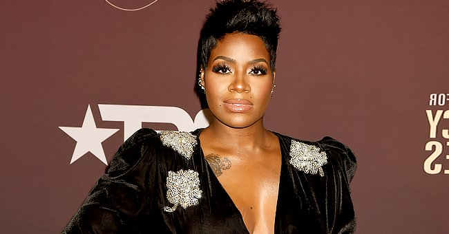 See Fantasia Posing in a Striped Peach Dress as She Embraces Her Growing Baby Bump (Photo)
