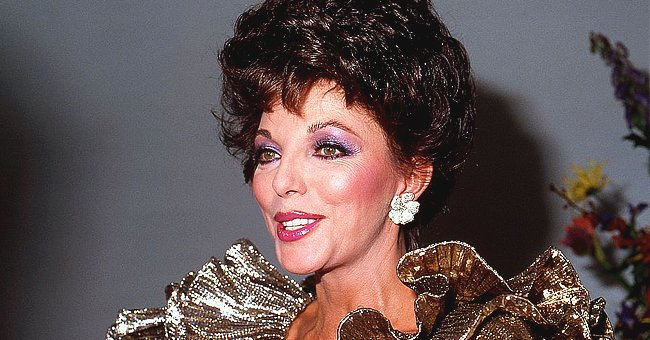 Joan Collins Wows Fans with Her Christmas Look in Sequin Trousers — Check It Out