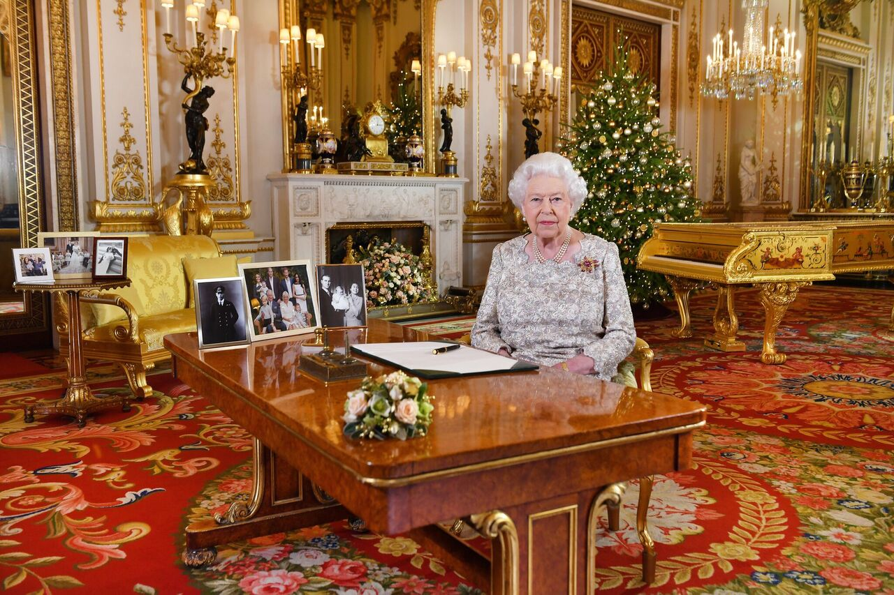 Queen Elizabeth II poses for a photo after she recorded her annual Christmas Day message, in the White Drawing Room at Buckingham Palace. | Source: Getty Images