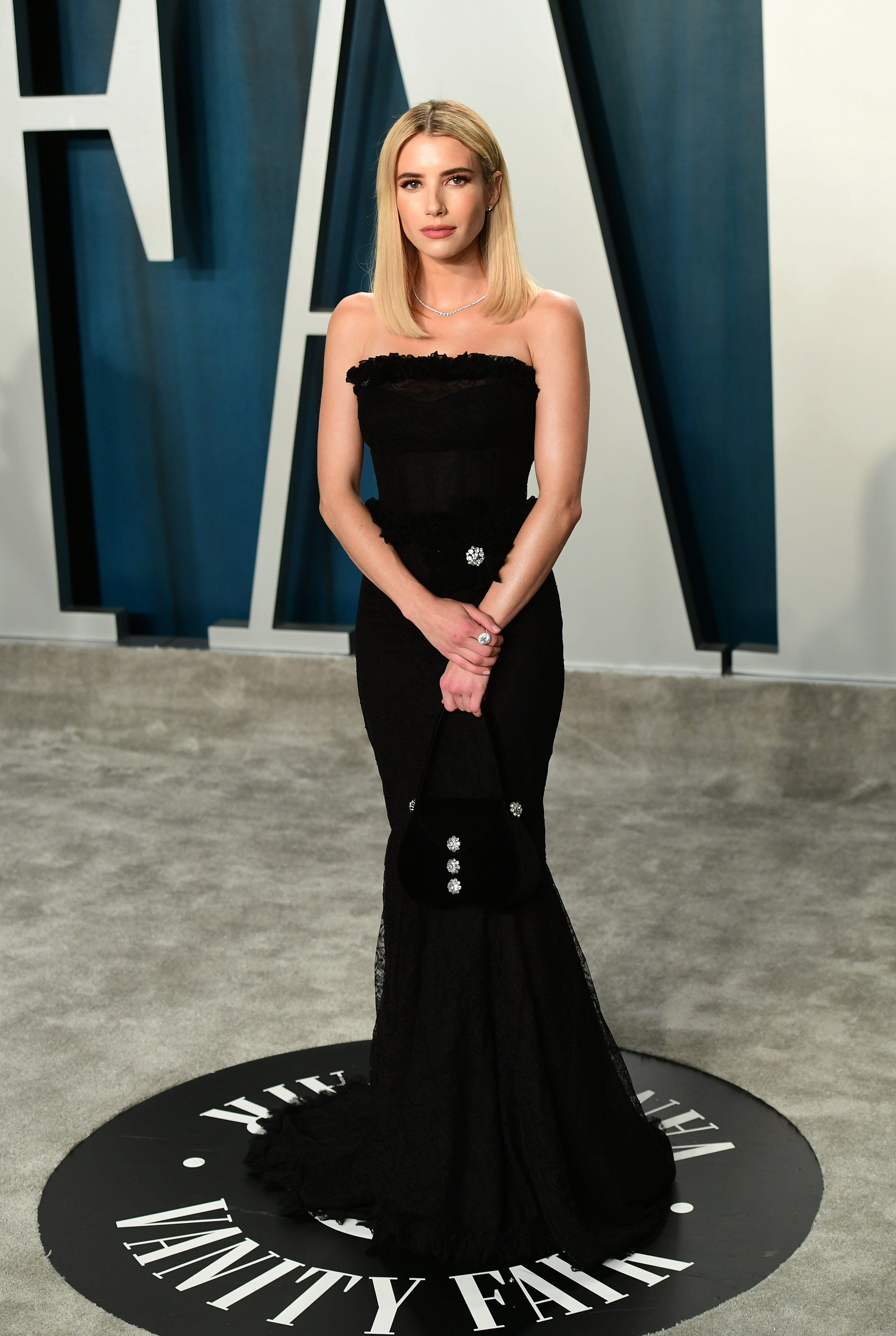 A statuesque Emma Roberts wore classic black to the 'Vanity Fair Pair' in Beverly Hills, February, 2020. | Photo: Getty Images.