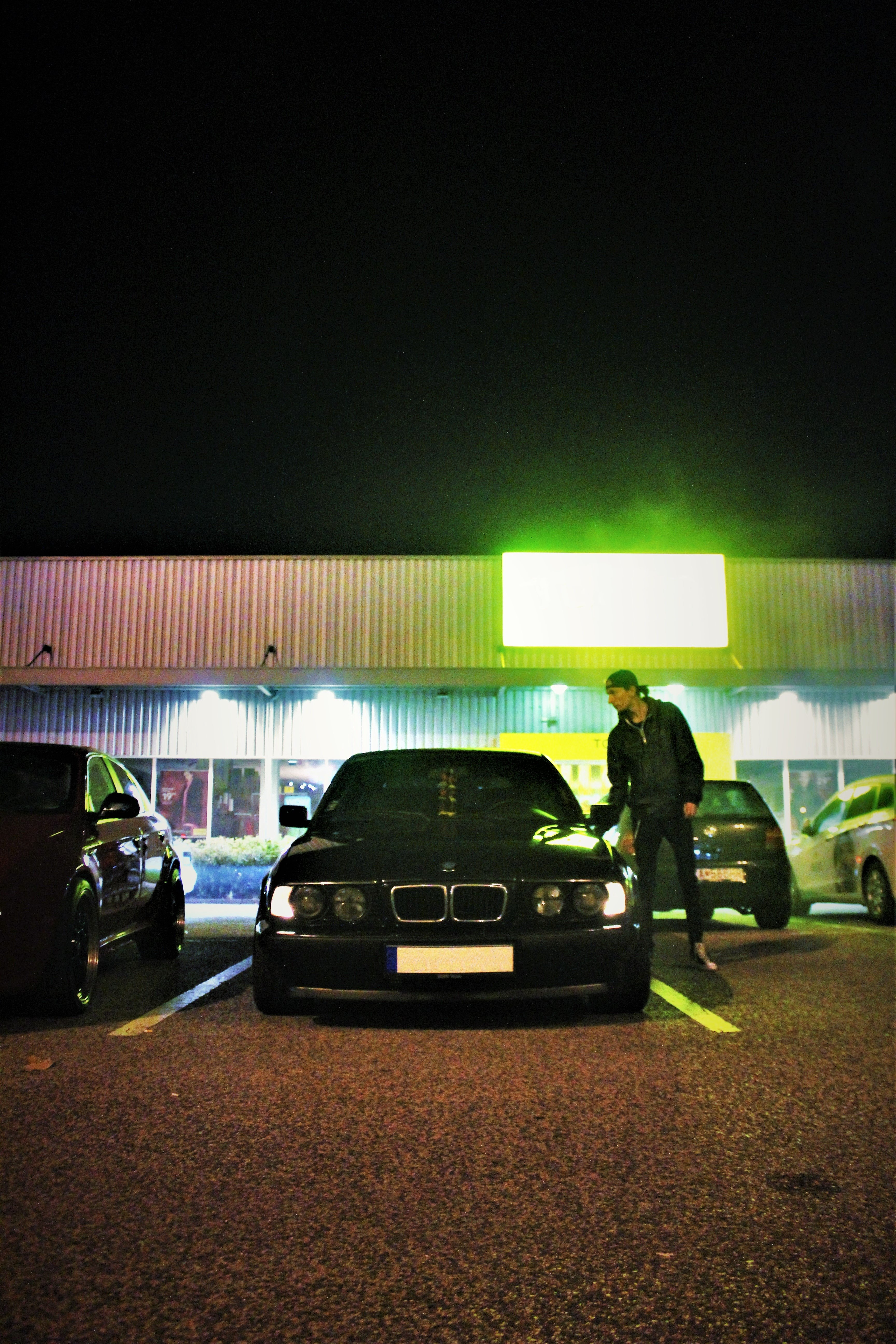 A man getting into his vehicle in a parking lot.   Pexels/ Adam Dubec