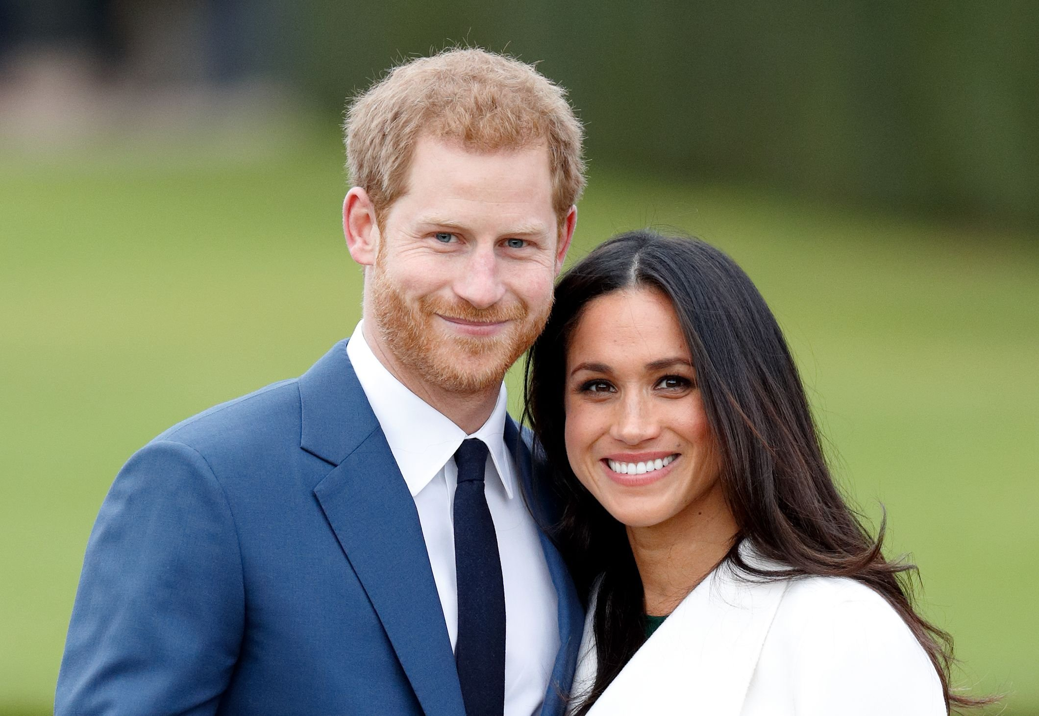 Prince Harry and Meghan Markle at an official photocall to announce their engagement at The Sunken Gardens, Kensington Palace on November 27, 2017 | Photo: Getty Images
