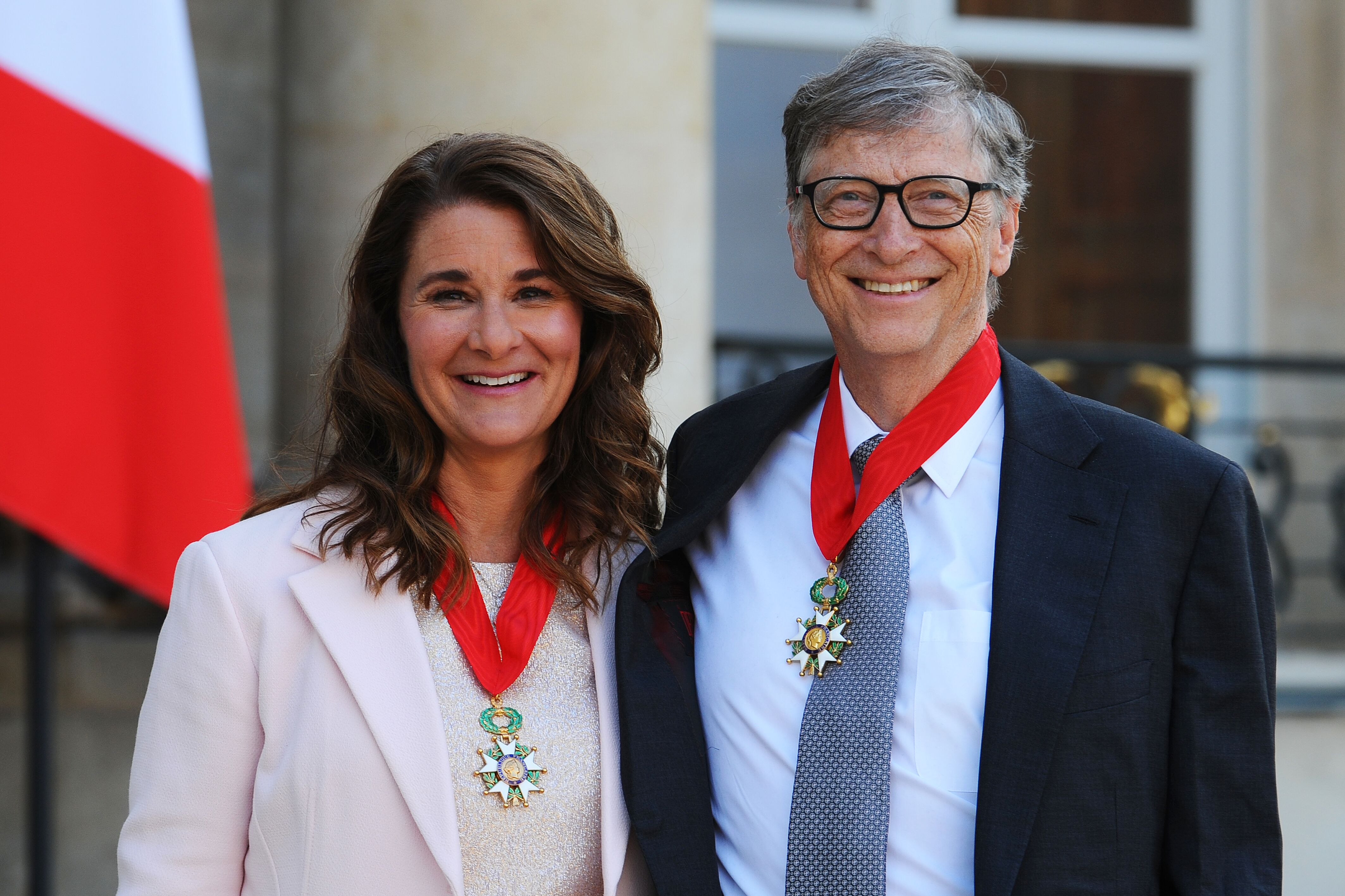 Bill and Melinda Gates pose in front of the Elysee Palace after receiving the award of Commander of the Legion of Honor by French President Francois Hollande on April 21, 2017 in Paris, France | Photo: Getty Images