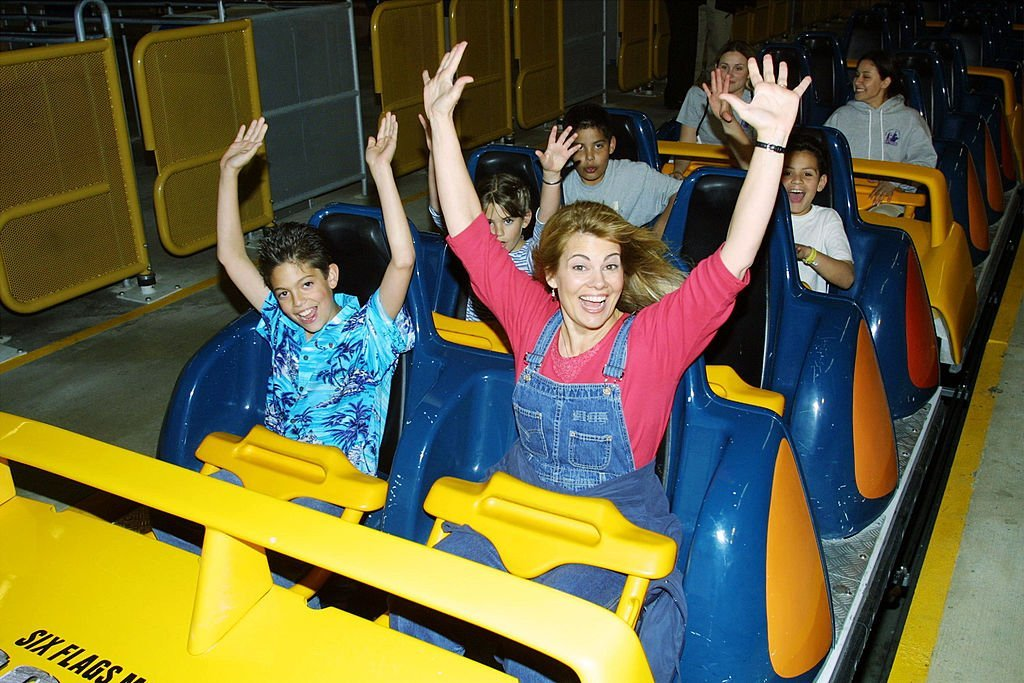 Lisa Whelchel and her son get ready to ride Goliath, a roller coaster, at Six Flags Magic Mountain | Getty Images