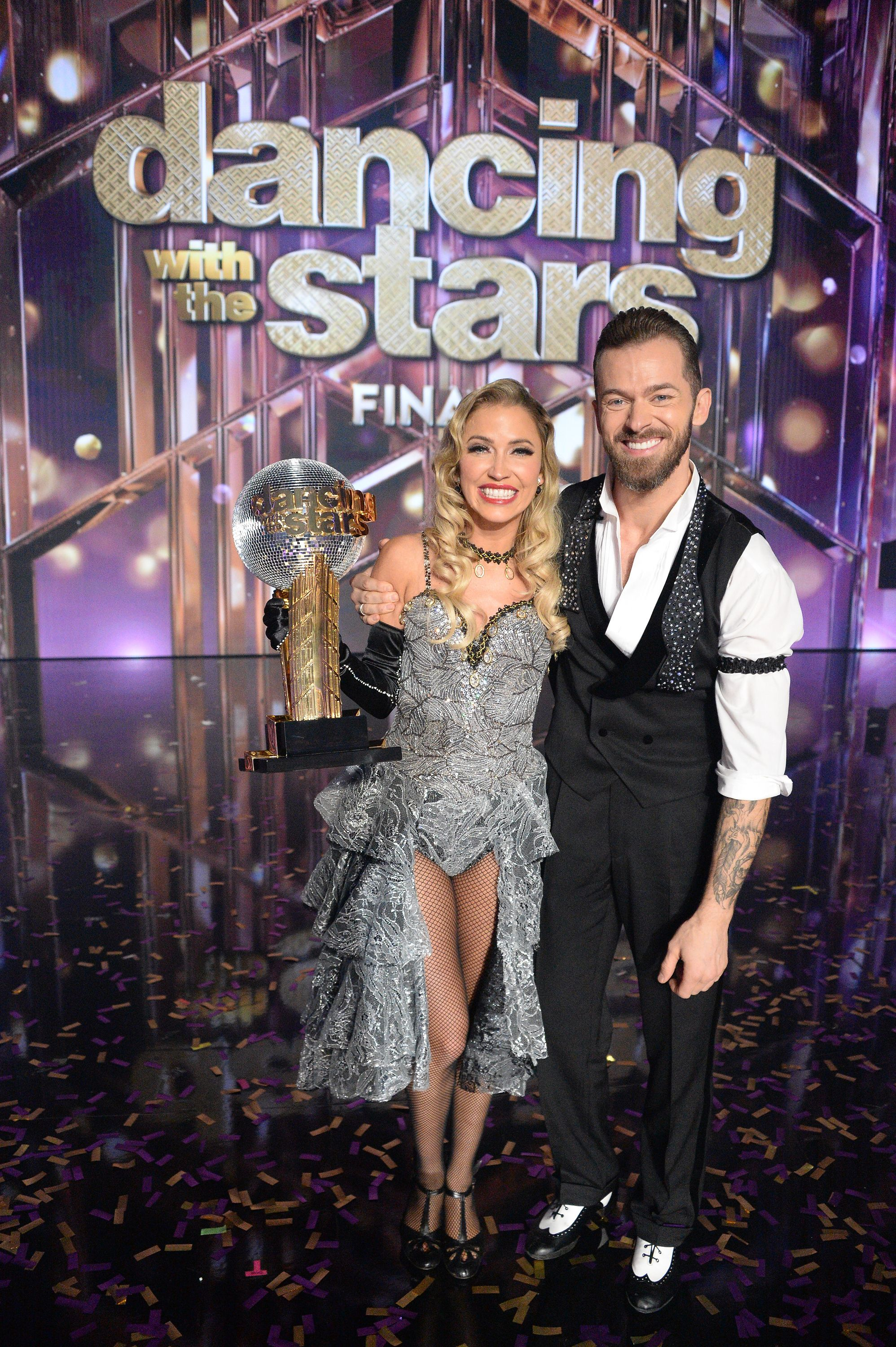 """""""Dancing WIth The Stars"""" competitors Kaitlyn Bristowe and Artem Chigvinstev with their Mirrorball Trophy 