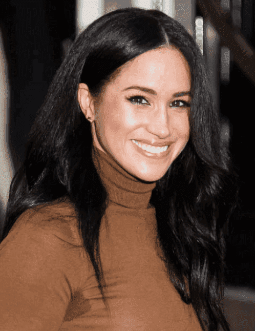Lors de sa première apparition publique en 2020, Meghan Markle salue la foule lorsqu'elle quitte la Maison du Canada, le 07 janvier 2020, à Londres, en Angleterre Source: Getty Images (photo de Samir Hussein / WireImage)