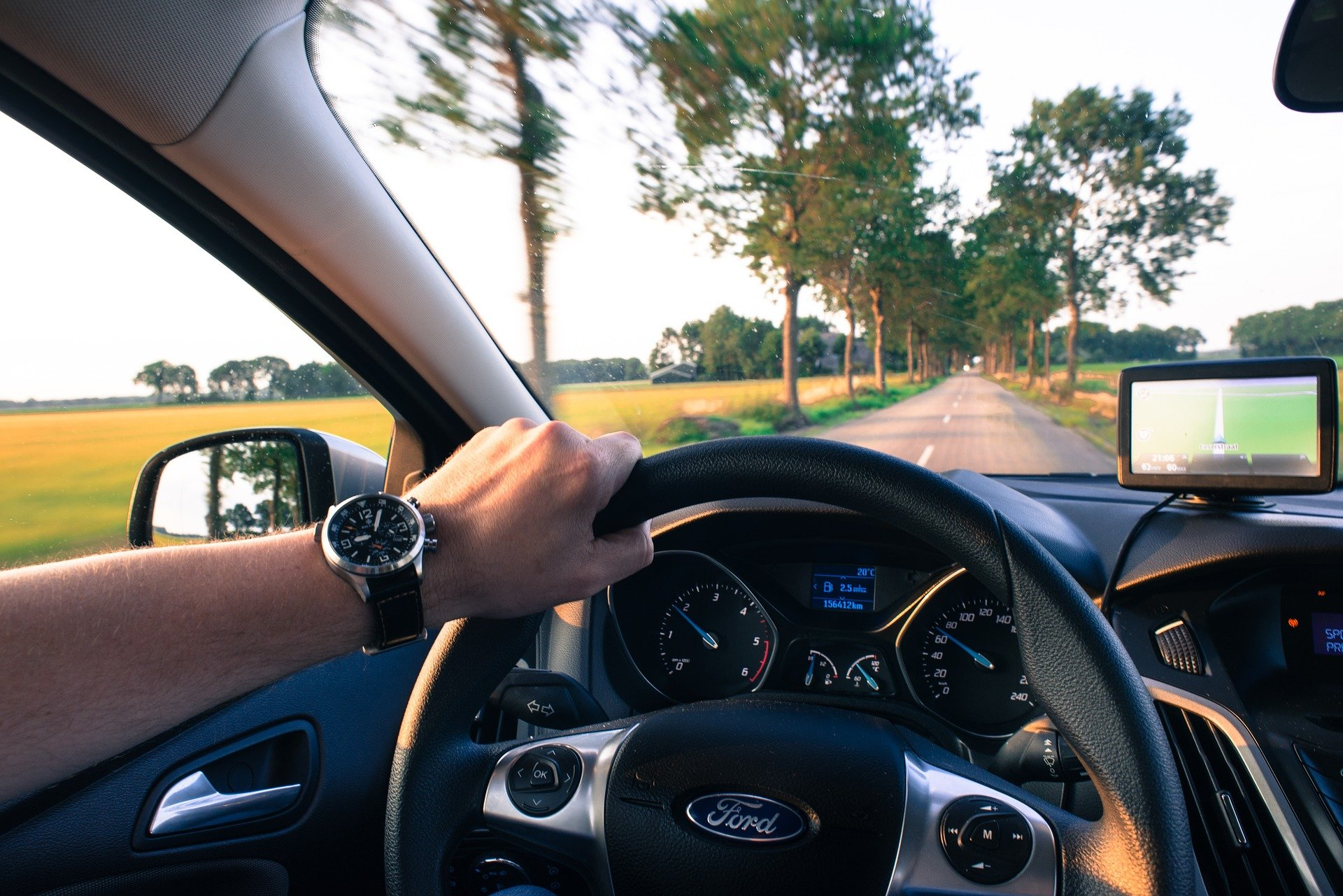 Pictured - A man driving using the navigation system   Source: Pixabay