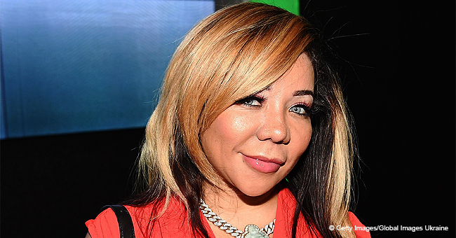 Tiny Harris Is a Bombshell in Blonde Ombre Waves and a Black Dress (Photo)