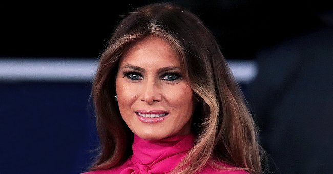 Melania Trump Goes Mask-Less to Meet Girl Scouts in Speckled Dress and Neon Orange Pumps