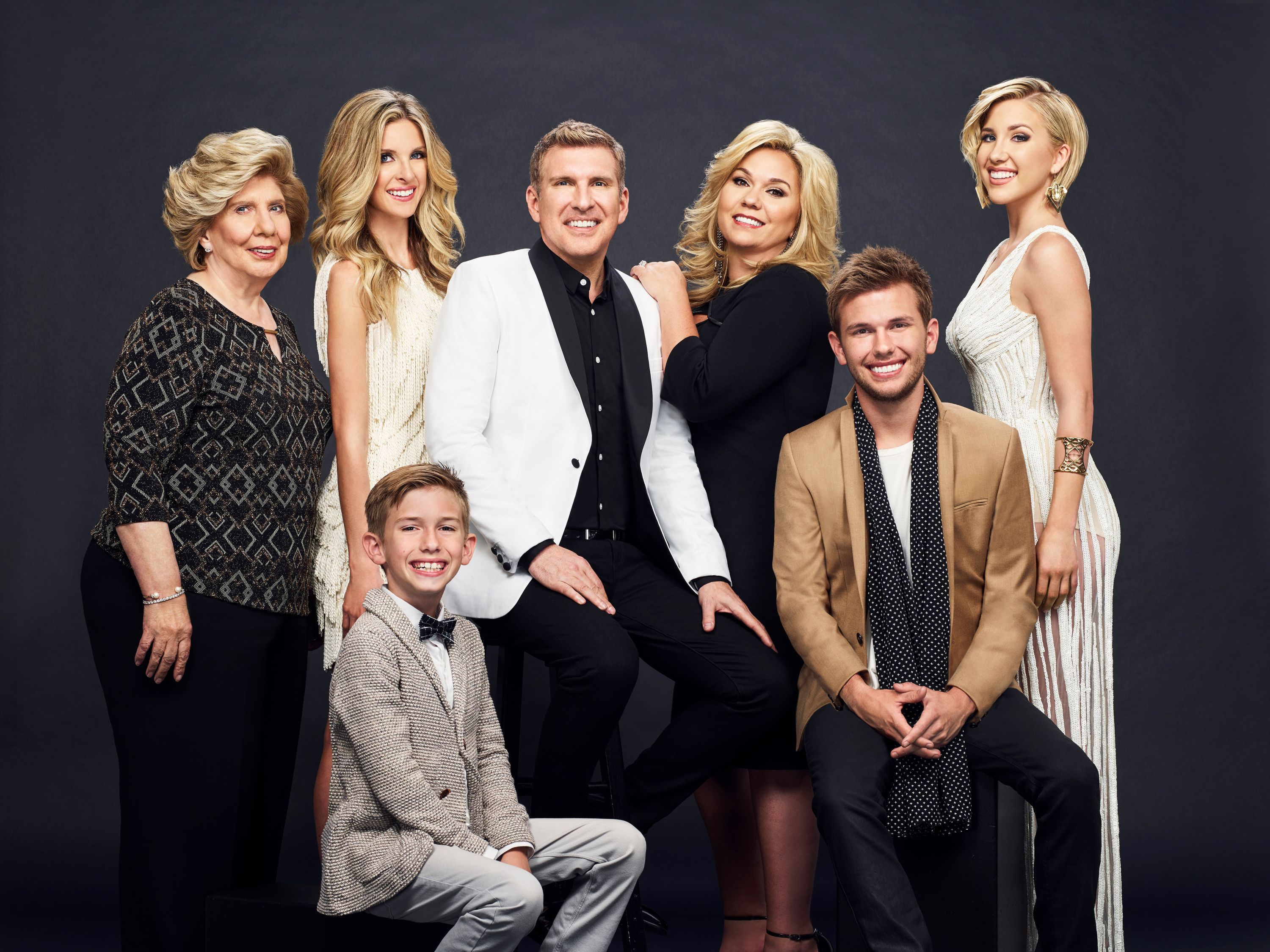 Faye Chrisley, Lindsie Chrisley Campbell, Grayson Chrisley, Todd Chrisley, Julie Chrisley, Chase Chrisley, Savannah Chrisley smile for a Season 4 family portrait. | Photo: Getty Images