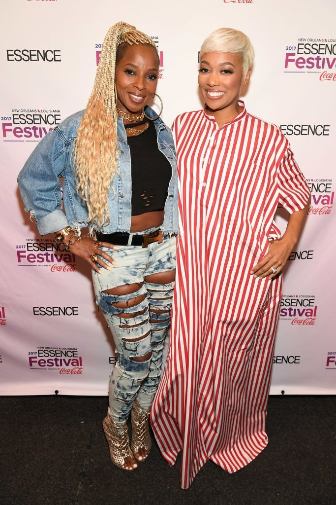 Mary J. Blige and Monica pose backstage at the 2017 ESSENCE Festival presented by Coca-Cola at Ernest N. Morial Convention Center | Photo: Getty Images