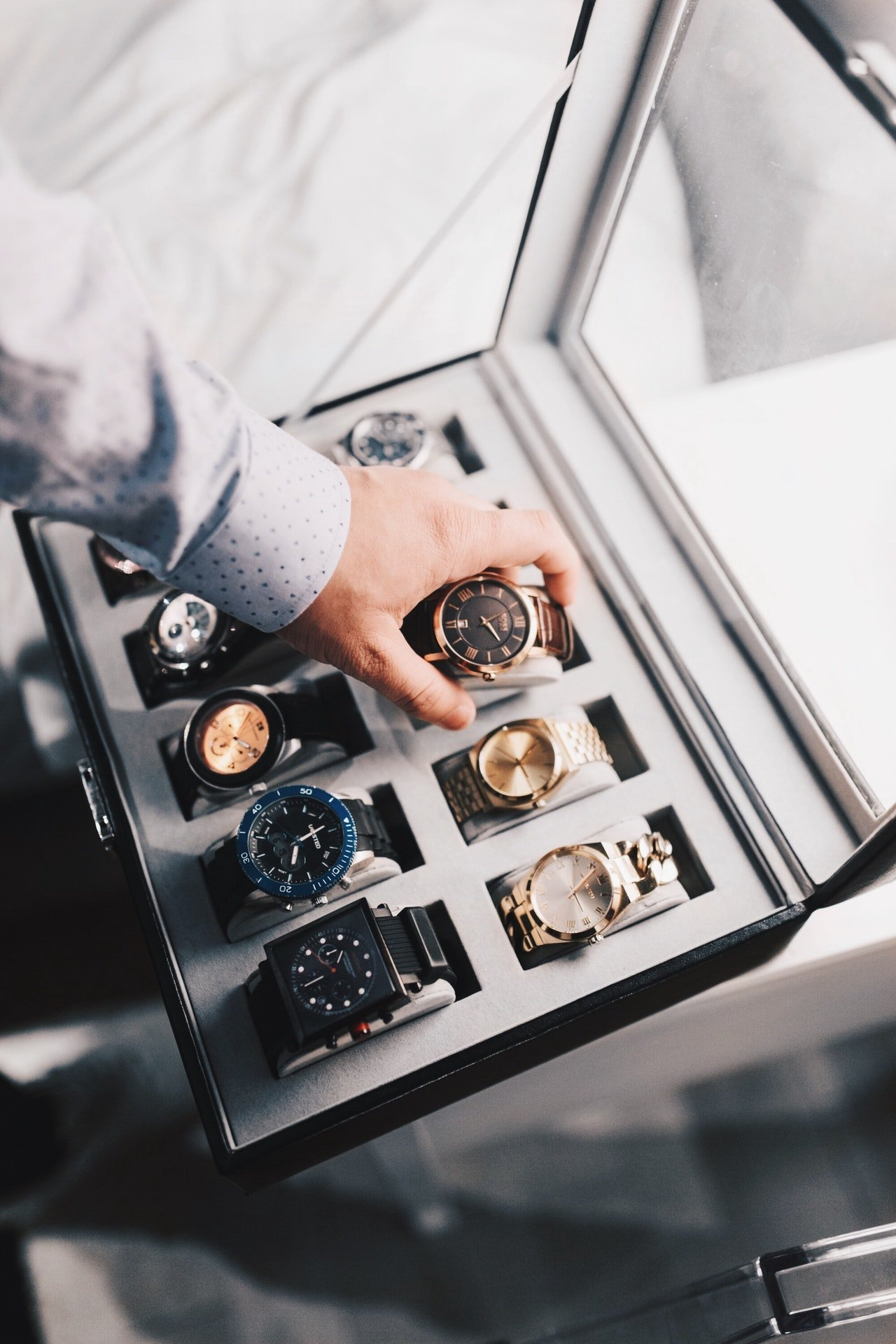 Collection of watches in a display case | Photo: Pexels