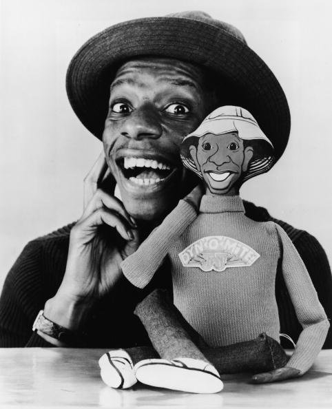 "Jimmie Walker with a talking doll based on his character 'J. J.' from the television series ""Good Times."" 