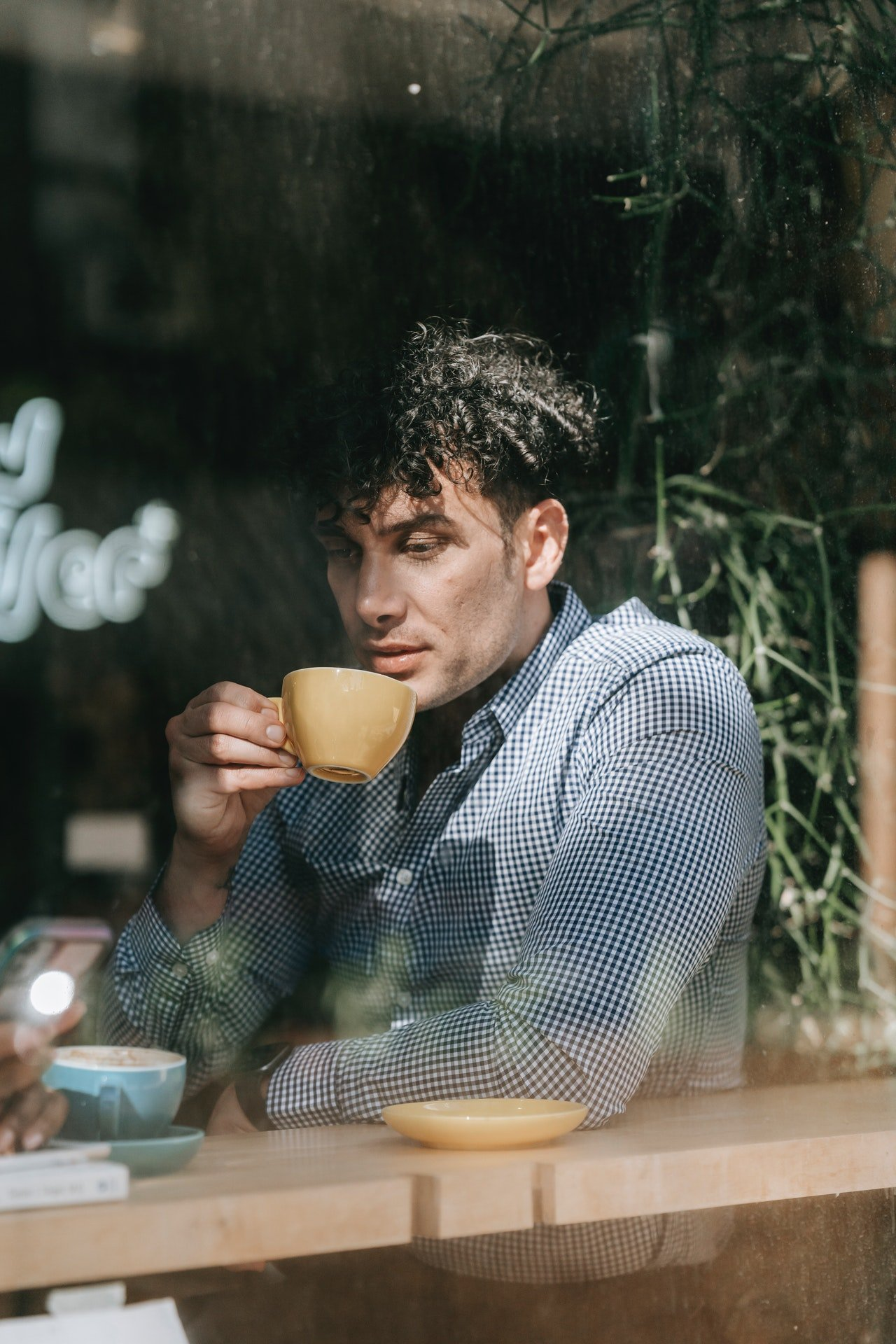 He ordered coffee and watched Amanda work.   Source: Pexels