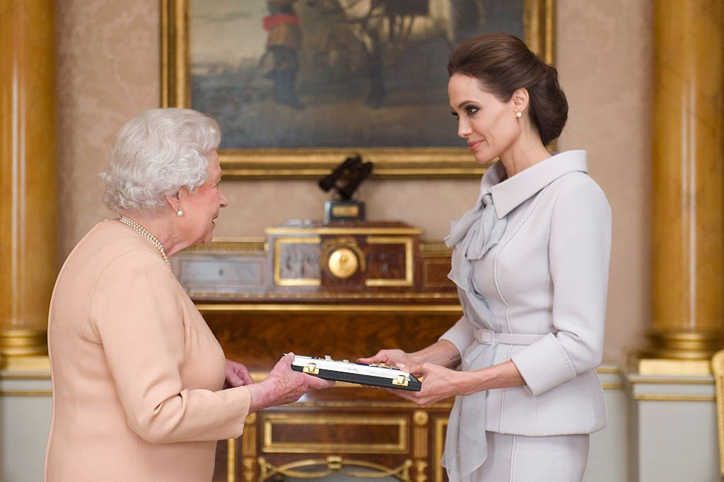 Angelie Jolie received an honorary damehood from the Queen Elizabeth, in London, 2014.   Source: Getty Images