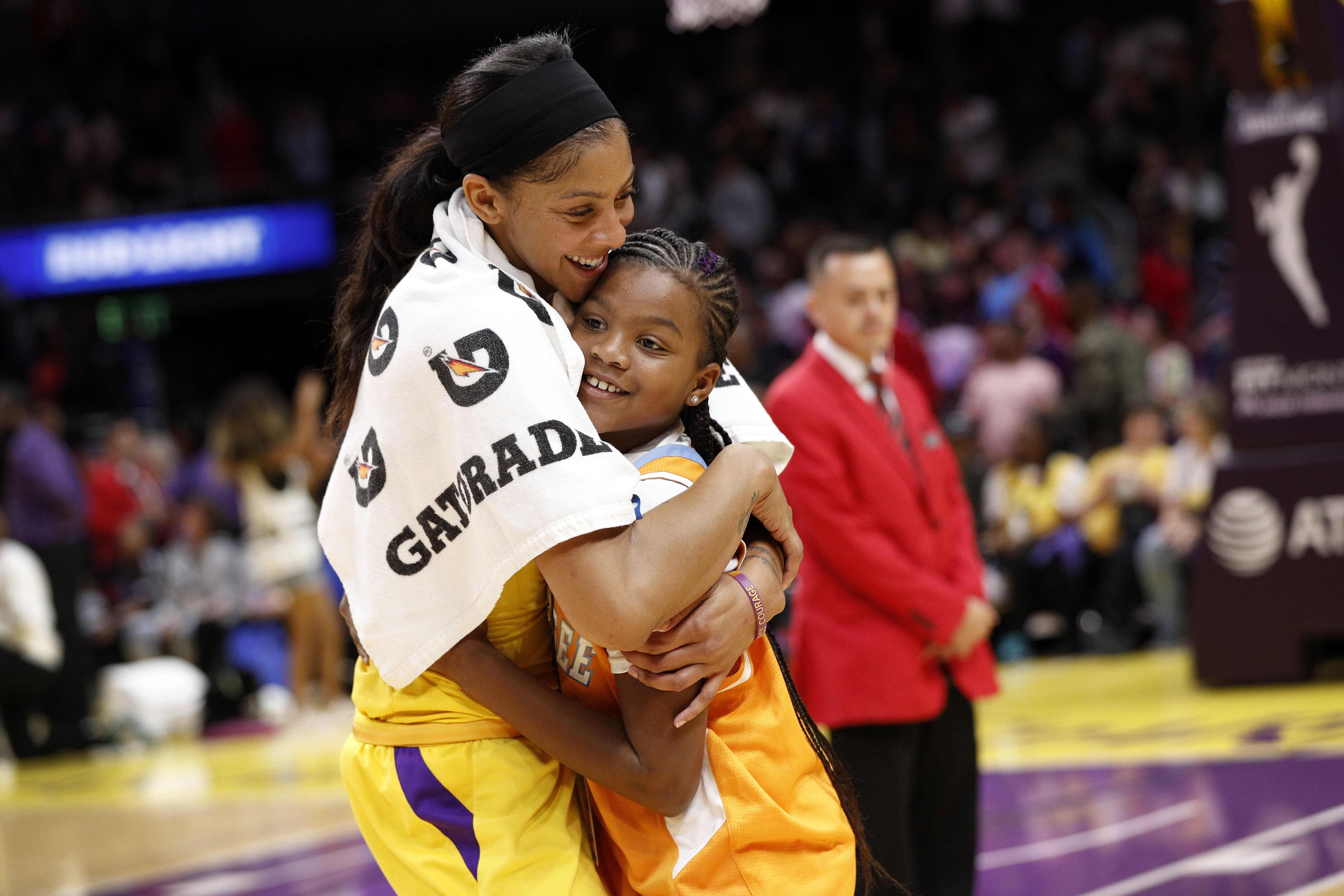 Candace Parkerhugs her daughter, Lailaa Nicole Williams, after winning the game against the Phoenix Mercury in 2019 | Source: Getty Images